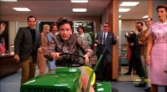 Lois Sandler drives a lawnmower