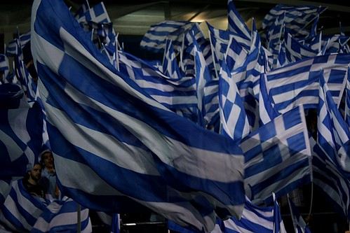 Sea of Greek flags being waved by New Democracy youth wing