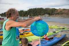 Small Peter affixing earth globe luminary at Break Free PNW 2016 photo by Alex Garland img_1799