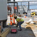 A Blue Grass Chemical Agent-Destruction Pilot Plant worker places piping under the Outside Operations Support Facility. This facility will support Explosive Destruction Technology operations to destroy the Blue Grass mustard agent stockpile.