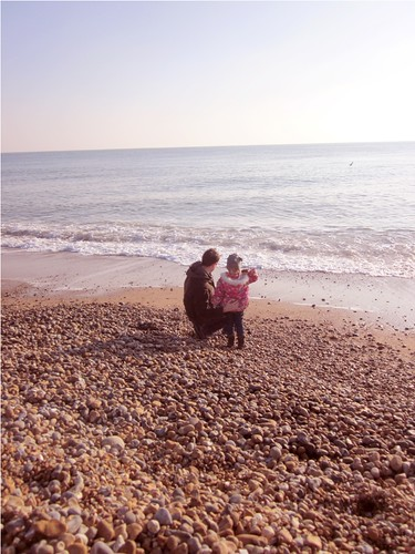Father and daughter on the beach by PhotoPuddle