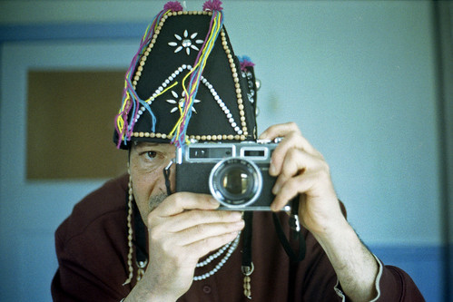 reflected self-portrait with Yashica Electro 35 GSN camera and Thai hat by pho-Tony