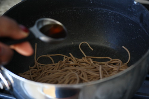Toss the noodles with sesame oil