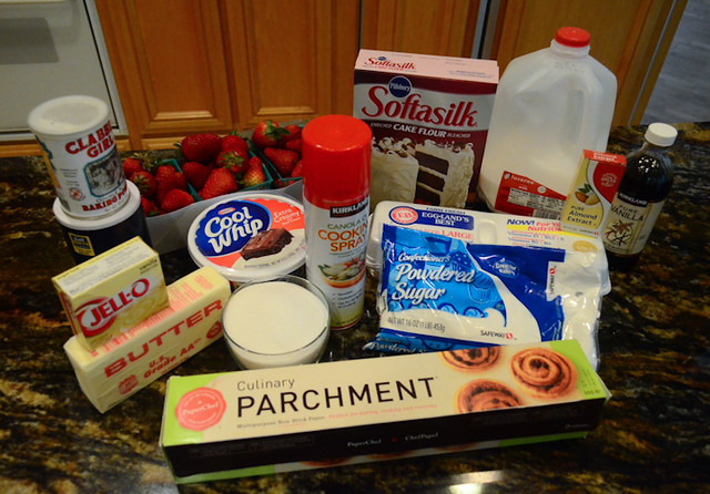 All the ingredients required for strawberries and cream cake arranged on a counter top.
