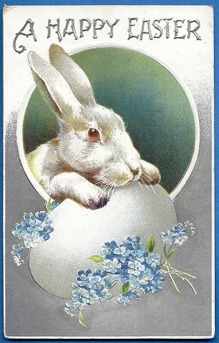 EasterBunnywithwhiteeggandblueflowers
