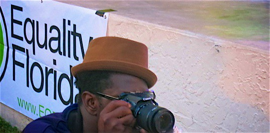 Black Camera man with brown cap