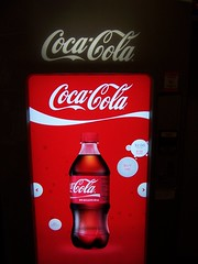 plant(0.0), liqueur(0.0), soft drink(1.0), red(1.0), carbonated soft drinks(1.0), drink(1.0), cola(1.0), coca-cola(1.0),