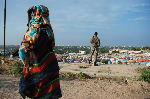 A soldier looks out over an IDP camp