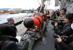 SAKAIMINATO, Japan (March 5, 2012) Mineman Seaman Bryan Surber, assigned to USS Patriot (MCM 7), mine neutralization vehicle operations to local media during a ship tour following the ship's arrival for a port visit. (U.S. Navy photo by Mass Communication Specialist 2nd Class Devon Dow)