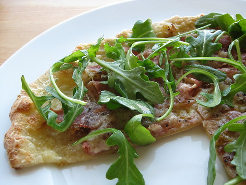 tarte gratinée, baked and topped with arugula