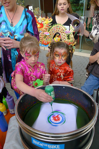 Girls entranced at the bicycle powered Spin Art Station
