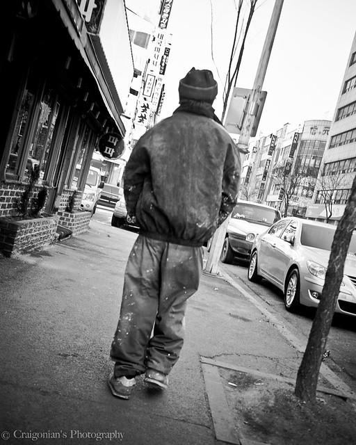 Old man walking down the street