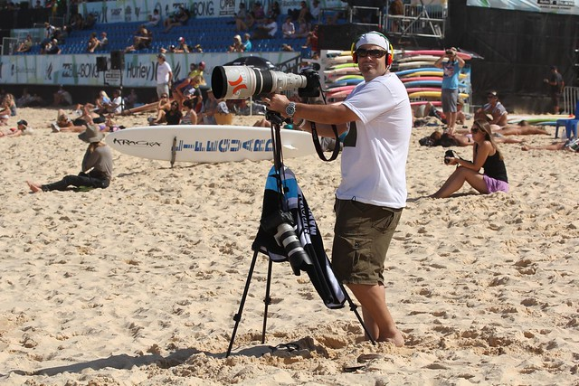 Photographer with long camera lens - Australian Open of Surfing  Manly Beach 2012