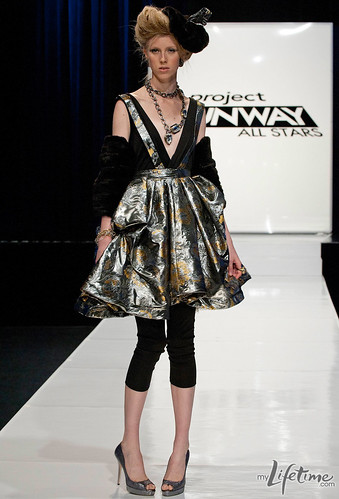 Austin's model in a gold and silver dress on the runway