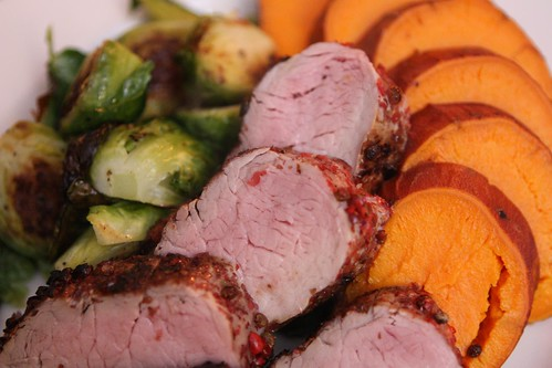 Pink Peppercorn Crusted Pork Tenderloin with Baked Sweet Potato and Roasted Brussels Sprouts