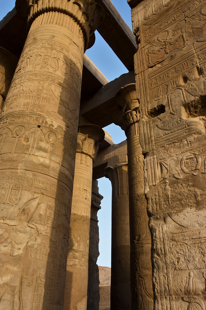 """Kom Ombo Temple - Nile - Egypt 2012 - Life on the Nile  The Temple of Kom Ombo is an unusual double temple built during the Ptolemaic dynasty in the Egyptian town of Kom Ombo.[1] Some additions to it were later made during the Roman period. The building is unique because its 'double' design meant that there were courts, halls, sanctuaries and rooms duplicated for two sets of gods. The southern half of the temple was dedicated to the crocodile god Sobek, god of fertility and creator of the world with Hathor and Khonsu. Meanwhile, the northern part of the temple was dedicated to the falcon god Haroeris, also known as Horus the Elder, along """"with Tasenetnofret (the Good Sister, a special form of Hathor) and Panebtawy (Lord of the Two Lands)."""" The temple is atypical because everything is perfectly symmetrical along the main axis.   The temple was started by Ptolemy VI Philometor (180-145 BC) at the beginning of his reign and added to by other Ptolemys, most notably Ptolemy XIII (51-47 BC), who built the inner and outer hypostyle halls. The scene on the inner face of the rear wall of the temple is of particular interest, and """"probably represents a set of surgical instruments.""""   Much of the temple has been destroyed by the Nile, earthquakes, and later builders who used its stones for other projects. Some of the reliefs inside were defaced by Copts who once used the temple as a church. All the temples buildings in the southern part of the plateau were cleared of debris and restored by Jacques de Morgan in 1893.   A few of the three-hundred crocodile mummies discovered in the vicinity are displayed inside the temple.  Source: en.wikipedia.org/wiki/Temple_of_Kom_Ombo  - All rights reserved.   © Rene Eriksen.   Please do not use my images outside of Flickr without my written permission."""