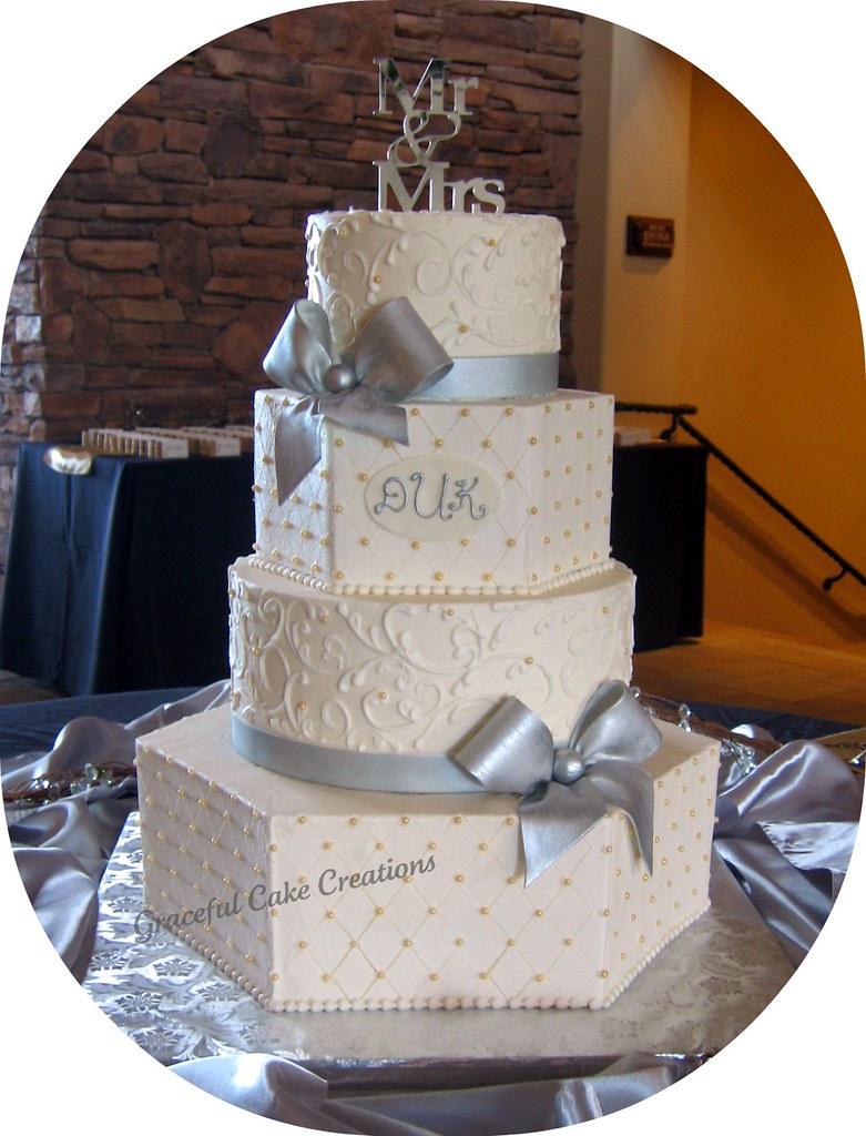 Elegant Ivory Wedding Cake With Silver Bows