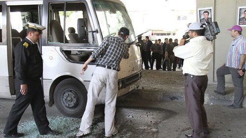 Syrian security forces inspect a truck damaged in an explosion outside a mosque on April 27, 2012. The attacks are a continuation of bombings carried out by opposition forces against the government of President Bashar al-Assad in Damascus. by Pan-African News Wire File Photos