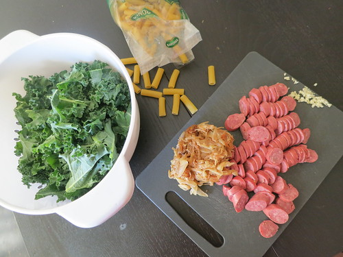 Sausage, kale, and caramelized pasta in a spicy Dijon sauce