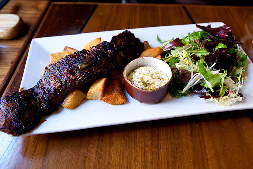 Grilled Spice Rubbed Skirt Steak Served with Patatas Bravas and Green ...