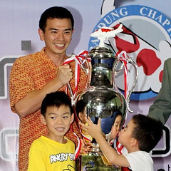 Winner Yohanes Jusuf and his two children