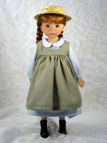 Anne in her arrival pinafore and outfit