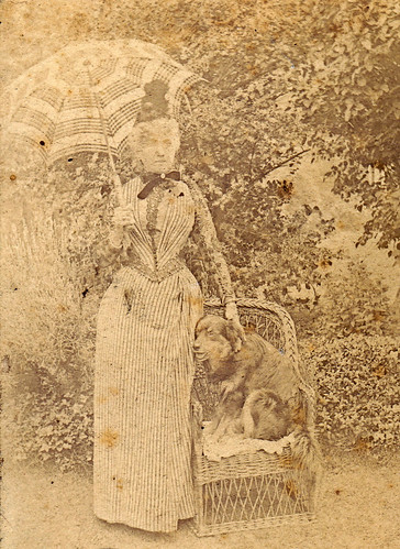 Faded woman with a parasol and a dog