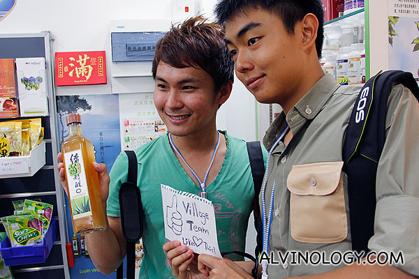 William and Nigel posing with a bottle of Luyin vinegar