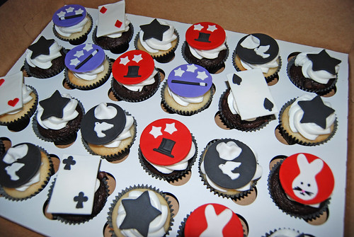magic themed cupcakes for a 7th birthday - stars, top hat, magician wand, cards, dove