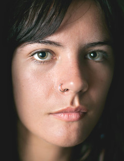 a closeup photo of Vallejo wearing a nose ring