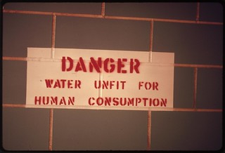 Sign in a restroom along Interstate 25 south of Colorado Springs, Colorado, warns that water is undrinkable, 04/1974
