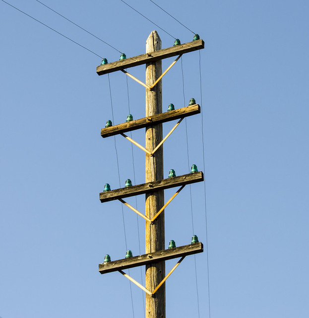 Telephone pole with glass insulators flickr photo sharing for Glass telephone pole insulators