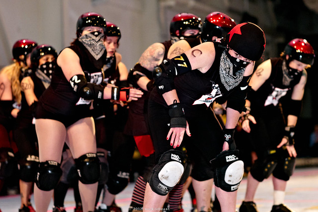 Jane Hammer leads the Oakland Outlaws in introduction laps to Bay Area's season opener against the Richmond Wrecking Belles.