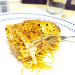 Lunch- leftover baked spaghetti in garlic bread. #carbs