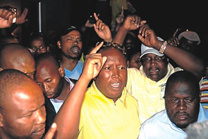 Julius Malema, President of the African National Congress Youth League in South Africa, has been expelled by the parent organization. He stood outside his grandmother's home with supporters after the news broke. by Pan-African News Wire File Photos