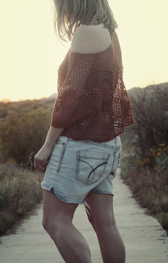 Top: Free People; Shorts: Calvin Klein; Boots:  Jeffrey Campbell; Earrings: