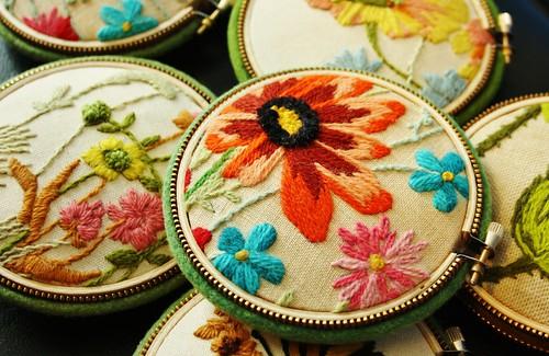 Vintage crewel pincushions