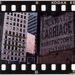 "According to Jump, this image taken on 47th Street in 1997 ""best illustrates the collision of two advertising eras and serves as a time capsule."" A friend called Jump after a building had been demolished to expose this ad. That didn't last long as one year later it was obscured again when a new building rose in the same lot. Jump notices the juxtaposition of ads in the background: one advertising Broadway shows, a spiraling red and white ad for Levi's rises above an ad for a stereo system. In the lower left corner of the image is a banner for ""Broadway Cares/Equity Fights AIDS."" Jump said he feels it's an on-going testament to the continual renewal of New York City.   Photo by Frank Jump."