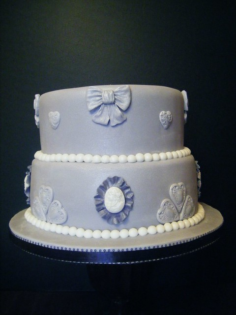 2 tier wedding cake covered with lilac fondant icing and decorated with