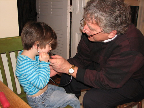 using Pa's stethoscope to listen to her heart