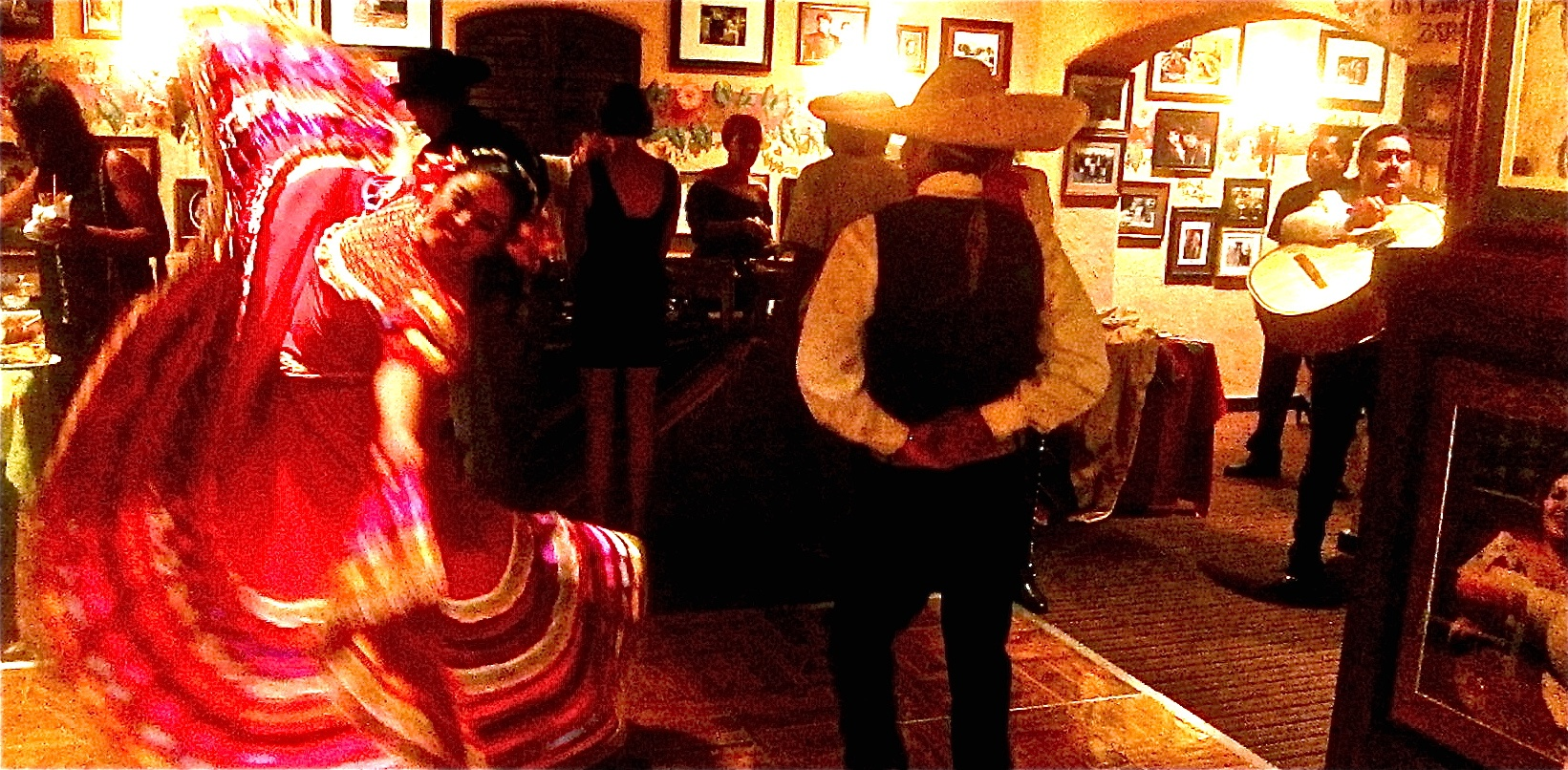 dancers and mariachas perform