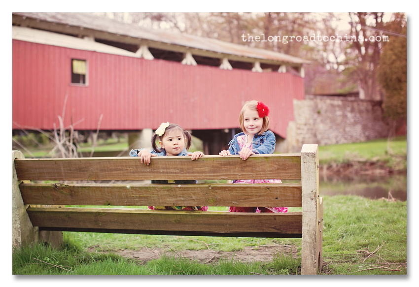 Backwards on the bench in front of the covered bridge BLOG