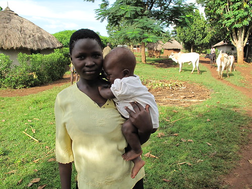 Mother, child and cows outside their homestead in Busia, Kenya