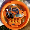 happy car orange plastic steering wheel by Andy M Johnson