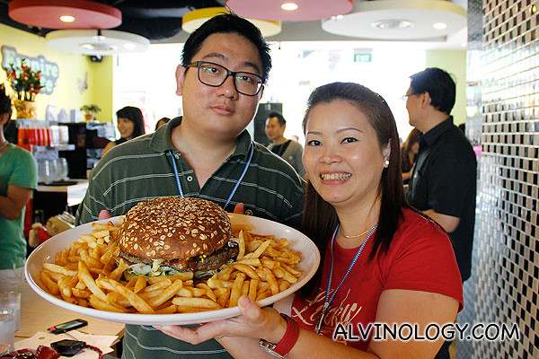 My colleague Jesslyn and I with the giant burger