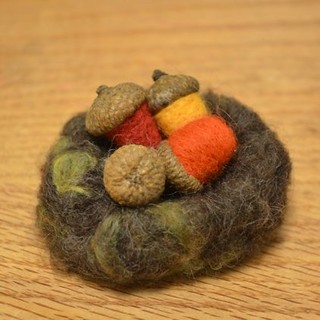 Needle-felted nest and acorns