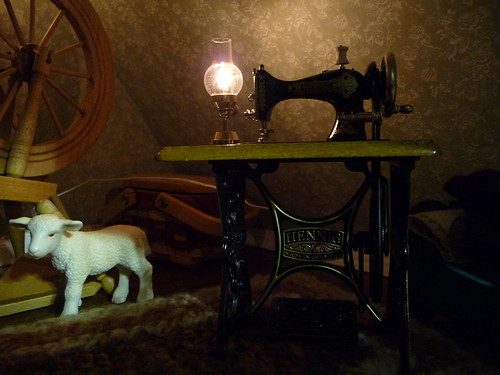 Sewing by oil lamp in the attic