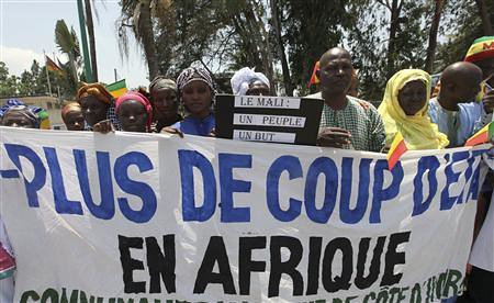 Citizens of Mali protest during the ECOWAS meeting where the Mali crisis and Guinea-Bissau coup were discussed in Abidjan on April 26, 2012. The regional group is set to deploy troops in both countries. by Pan-African News Wire File Photos
