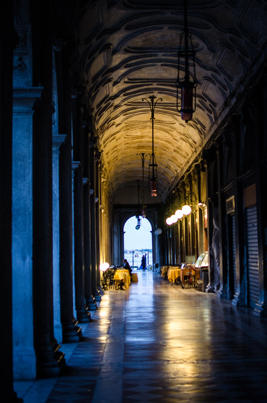 A twilight lit arcade at St. Mark's Square in Venice.