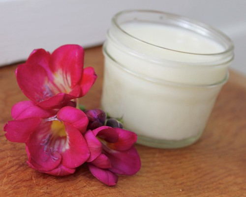 Rose Body Cream Recipe with Rose and Ylang Ylang! This plant based, rose body cream recipe is perfect both for hydrating dry skin. It's also wonderful on freshly shaved legs! Keep reading to learn how to make your homemade body cream recipe that's naturally scented with roses and ylang ylang.